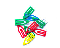 Multi-colored paper clips on a white background Stock Images