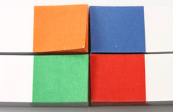 Multi-colored paper. Four sets of sticky pieces of paper for notes of green, blue, red and orange Stock Photos