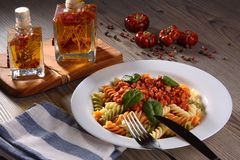 Multi colored pasta with vegetable Stock Photography