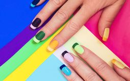 Multi-colored pastel manicure. stock photography
