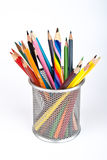 Multi colored pencil. S in a cup. Isolated on white background royalty free stock photos