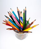 Multi colored pencil. S in a cup. Isolated on white background Royalty Free Stock Photo