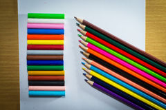 Multi colored pencils in a corner on a white background.  Royalty Free Stock Photo