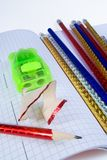 Multi-colored pencils and sharpener Stock Photography