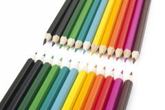 Multi-colored pencils on a white background. Wooden pencils of different colors on a white background Stock Images