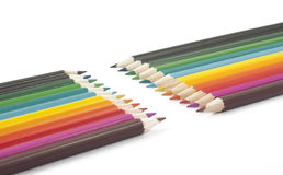 Multi-colored pencils on a white background. Wooden pencils of different colors on a white background Royalty Free Stock Photography