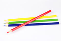 Multi colored pencils on a white background Royalty Free Stock Images