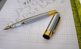 Multi-colored pens beautifully laid on the writing table. royalty free stock photography