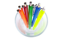 Multi-colored pens in a glass Stock Photos