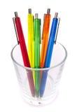 Multi-colored pens in a glass Stock Photo