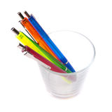 Multi-colored pens in a glass Stock Images