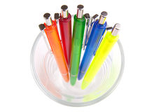 Multi-colored pens in a glass Royalty Free Stock Image