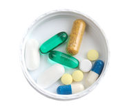 Multi-colored pills. Lie in vial's lid Stock Photography