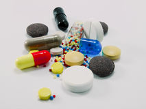 Multi-colored pills Stock Images