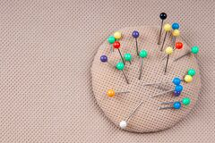 Free Multi-colored Pins For Sewing In A Pillow For Pins. Needlework Concept Royalty Free Stock Image - 174717826