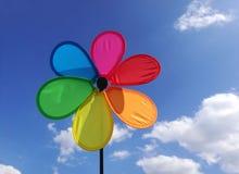 Multi colored pinwheel toy, blue sky royalty free stock image