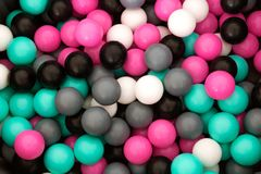 Multi-colored plastic balls for children`s games, for the pool. Photo of Multi-colored plastic balls for children`s games, for the pool royalty free stock images