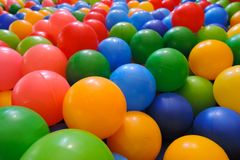 Multi-colored plastic balls for dry pool kid entertainment close-up royalty free stock image