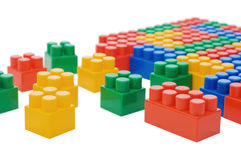 Multi-colored plastic blocks on white Royalty Free Stock Photo
