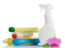 Multi-colored plastic bottles with liquid detergent and orchid isolated. Royalty Free Stock Image