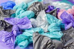 Multi-colored plastic garbage bags rolled into bows stock photo