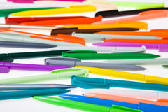 Multi-colored plastic pens Royalty Free Stock Image