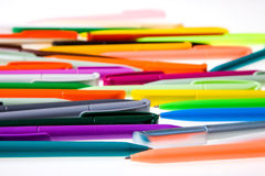 Multi-colored plastic pens Royalty Free Stock Photos