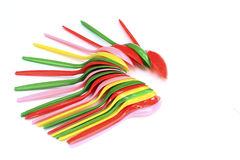 Multi-colored plastic spoons Royalty Free Stock Images