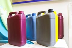 Multi-colored plastic yellow red gray blue yellow cans with a handle for liquids, fuels, oils stock photo