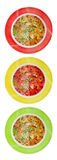 Multi-colored plates with vegetable soup Royalty Free Stock Images