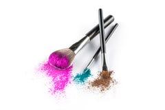 Multi Colored Powder Eyeshadow on a Brush, fashion beauty tool Royalty Free Stock Photo