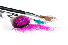 Multi Colored Powder Eyeshadow on a Brush, fashion beauty tool Royalty Free Stock Images
