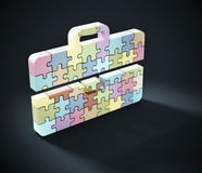 Multi colored puzzle pieces forming briefcase icon. 3D illustration.  Stock Photography
