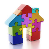 Multi colored puzzle pieces forming a house. 3D illustration.  Royalty Free Stock Image
