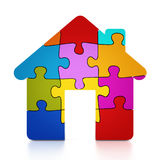 Multi colored puzzle pieces forming a house. 3D illustration.  Royalty Free Stock Images