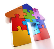 Multi colored puzzle pieces forming a house. 3D illustration.  Stock Photos