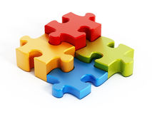 Multi colored puzzle pieces. Isolated on white background Stock Images