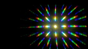Multi colored rainbow star burst overlay. Against a black background royalty free stock photography