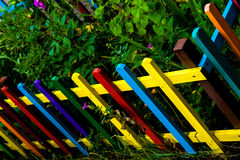 Multi colored rainbow wooden fence in garden Royalty Free Stock Photos