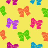 Multi-colored ribbons on a yellow background. Seamless pattern royalty free illustration