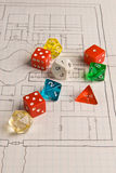 Role Play style dice and map. Multi-colored role play dice sitting on a graph paper game map. A shallow depth of field used to throw the background out of focus Royalty Free Stock Photos