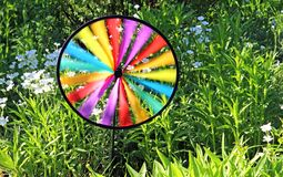Multi colored round pinwheel in motion royalty free stock image