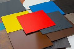 Multi-colored samples of composite materials for the ventilated facades in showroom royalty free stock photos