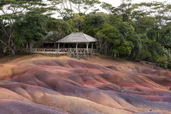 Multi-colored sand  of Chamarel and cafe Royalty Free Stock Photo