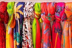 Multi colored scarves hanging royalty free stock photography