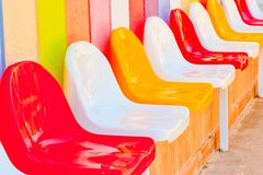 Multi-colored seats for children Royalty Free Stock Images