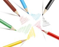 Multi-colored self-drawing pencils on white paper from different sides. stock photo
