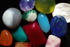 Multi-colored semi-precious stones on black close-up Royalty Free Stock Photo