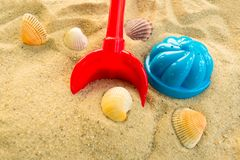 A multi-colored set of children`s toys for the summer games in the sandbox or on the sandy beach. The concept of  holidays stock photos