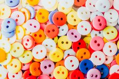 Multi-colored sewing buttons. As background royalty free stock image